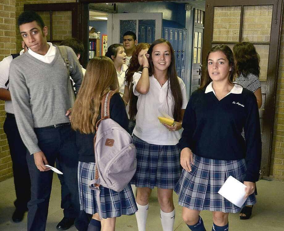 Back to schoolStudents at St. Augustine High School walk to their next class as the school year starts Wednesday for all Catholic schools in Laredo. (Photo by Cuate Santos/Laredo Morning Times)