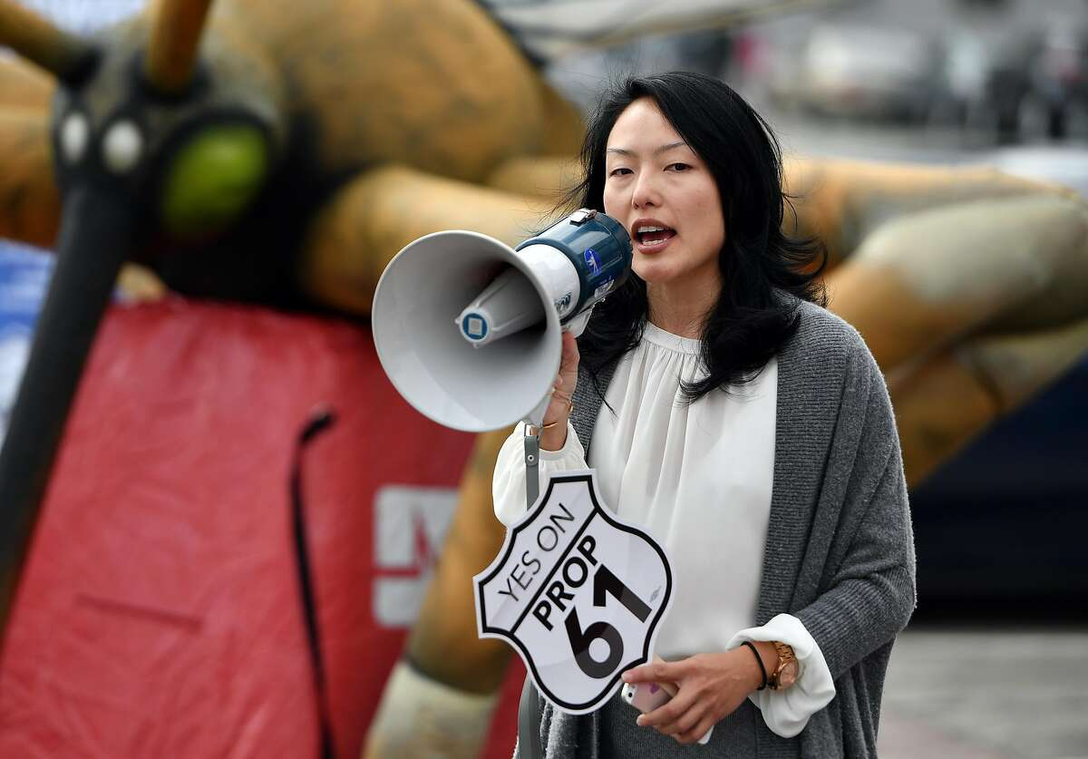 """IMAGE DISTRIBUTED FOR AIDS HEALTHCARE FOUNDATION - San Francisco County Supervisor Jane Kim addresses a crowd during a """"Yes on Prop 61"""" rally outside City Hall in San Francisco on Tuesday, October 11, 2016. San Francisco elected officials, veterans, nurses and volunteers spoke during the event to slam big pharma and their ever increasing costs for drugs. (Josh Edelson/AP Images for AIDS Healthcare Foundation)"""