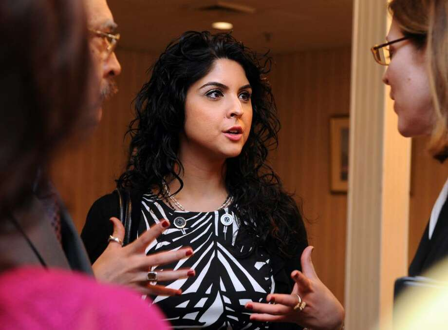 Maryam Rahman, 26, of Cromwell, talks with FBI special agent Kim Mertz, of the FBI's New Haven office, Saturday May 15, 2010 during a meeting of the Pakistani American community in Connecticut with law enforcement agencies and state and federal leadership at the Ramada Inn in Stratford. Photo: Autumn Driscoll / Connecticut Post