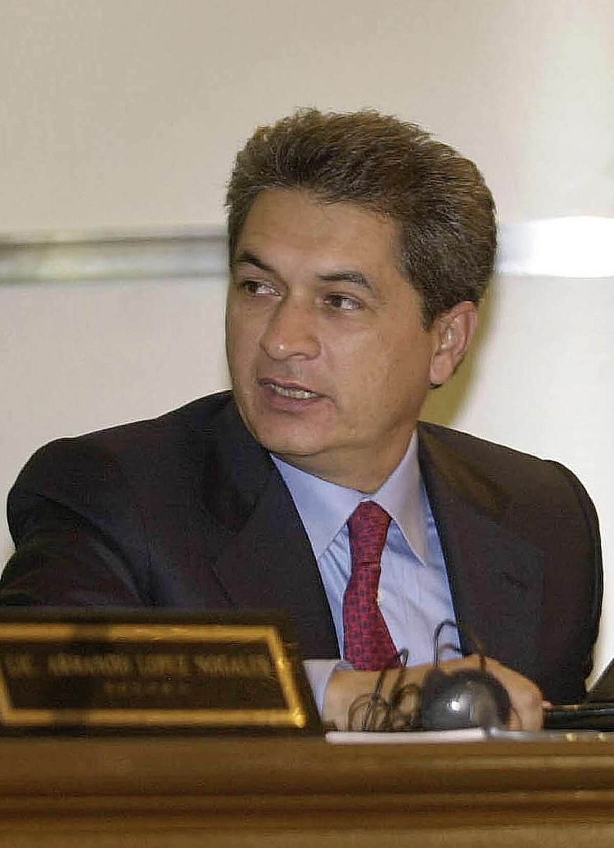 """In this Friday, Aug. 8, 2003 photo, former Tamaulipas state Governor Tomas Yarrington participates in the XXIth Border Governors Conference in Chihuahua, Mexico. On Wednesday, Aug. 29, 2012, Mexico's Attorney General requested help from Interpol in arresting Yarrington after a judge ordered his arrest for allegedly fomenting drug trafficking. U.S. authorities allege that Yarrington """"acquired millions of dollars in payments"""" while in public office from drug cartels """"and from various extortion or bribery schemes."""" (AP Photo/Jaime Puebla, File)"""