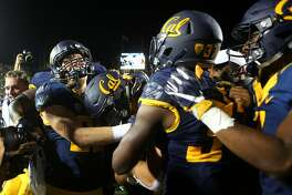 California linebacker Jordan Kunaszyk, second left, celebrates with teammates after his interception defeated Oregon during the second overtime on October 21, 2016 in Berkeley, Calif.