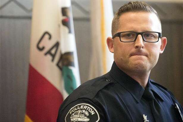 Fullerton, Calif., Police Sgt. Jon Radus tells media that police have arrested two men and a 17-year-old girl in connection with the slaying of three adults in a Fullerton house at the Fullerton Police Department in Fullerton. (Cindy Yamanaka/The Orange County Register via AP)