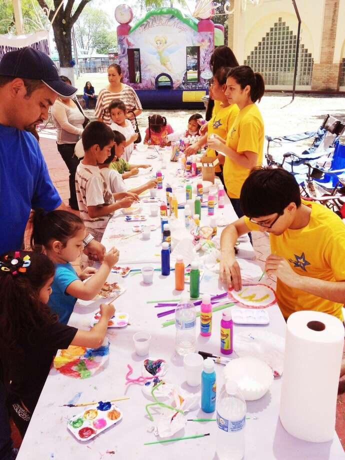 Children enjoy arts and crafts at one of the many booths available during SCAN Annual Children Play Day at the Laredo Civic Center Sunday afternoon. (Photo by Ulysses S. Romero/Laredo Morning Times)