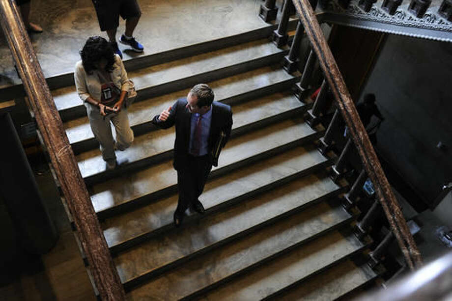 Rep. Jeremy Durham of Franklin walks down the steps talking to reporters as he leaves the Capitol before a vote to expel him from the House of Representatives was taken during a special session Tuesday Sept. 13, 2016, in Nashville, Tenn. Forty seven Republicans were joined by 23 Democrats Tuesday to vote to oust Durham from the Tennessee state Legislature. Durham faced allegations of sexual harassment detailed in a state attorney general's report. He denied most of them. (George Walker IV/The Tennessean via AP)