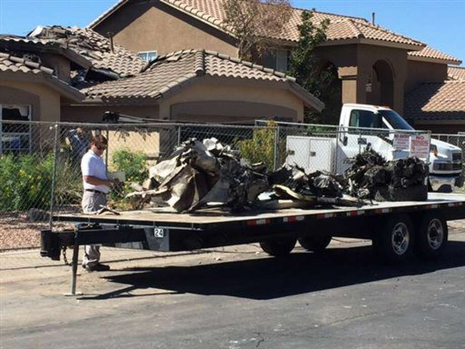 Wreckage from a plane that crashed into a home in Gilbert, Ariz., sits on a flatbed on Sunday, Sept. 18, 2016. Federal investigators are trying to determine what led the plane carrying several skydivers to crash Saturday. The pilot and four skydivers were able to parachute out before the aircraft struck the house. (Gary Hildebrandt/Gilbert Fire Department via AP)