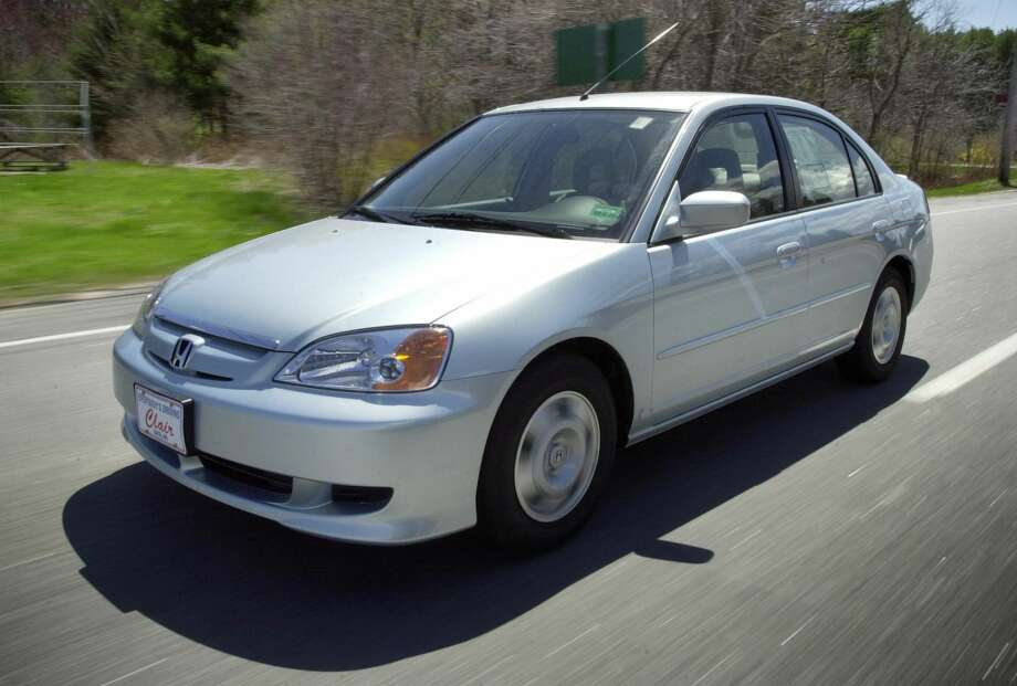 This April 25, 2002 file photo shows the Honda Civic Hybrid in Saco, Maine. More than 1 million vehicles in North America are part of a worldwide recall for an airbag problem affecting three big automakers. Toyota, Honda and Nissan are recalling more than 2 million vehicles because the inflator on the passenger side may burst, sending plastic pieces flying. Some of the vehicles being recalled are the Honda Civic, Toyota Corolla, Tundra and Lexus SC built between November 2000 and March 2004. (AP Photo/Robert F. Bukaty, File)