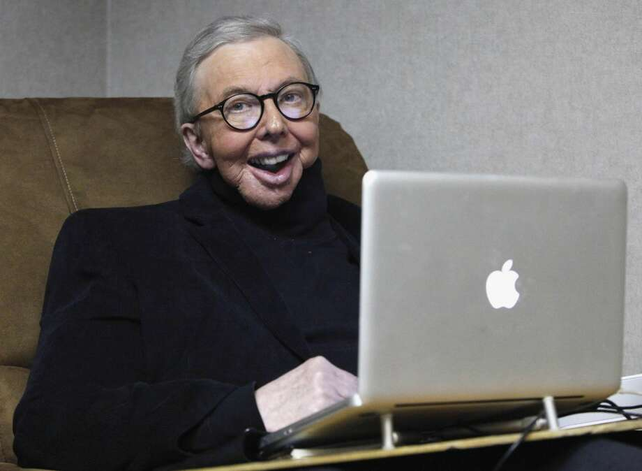 In this Jan. 12, 2011 file photo, Pulitzer Prize-winning movie critic Roger Ebert works in his office at the WTTW-TV studios in Chicago. In an essay posted Tuesday, April 2, 2013, Ebert says that he has cancer again and is scaling back his movie reviews while undergoing radiation. The veteran critic has previously battled cancer in his thyroid and salivary glands and lost the ability to speak and eat after surgery. The Associated Press is reporting that Ebert has died. (AP Photo/Charles Rex Arbogast, File) Read more