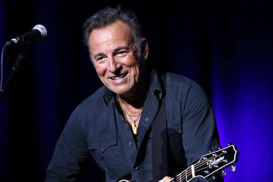 """FILE - In this Nov. 10, 2015 file photo, Bruce Springsteen performs at the 9th Annual Stand Up For Heroes event in New York. A Philadelphia fifth-grader ditched school for the chance to meet the rock legend at his book signing Thursday, Sept. 30, 2016, and The Philadelphia Inquirer reports """"The Boss"""" gladly played along by signing the boy's absence excuse note. (Photo by Greg Allen/Invision/AP, File)"""