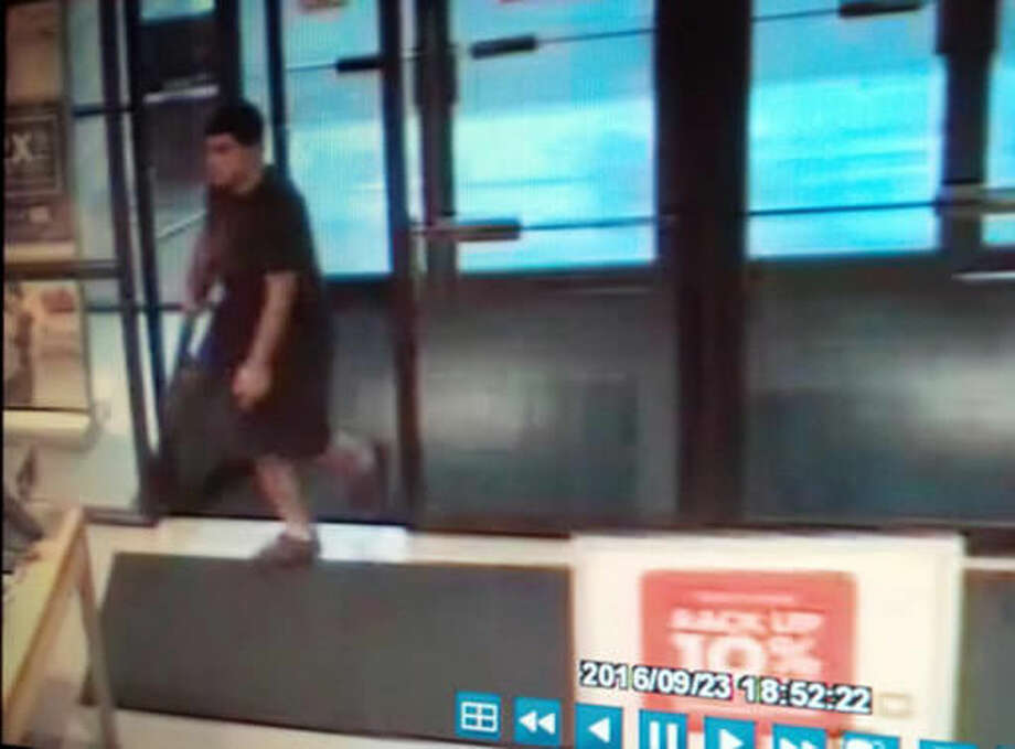 This Friday, Sept. 23, 2016 frame from surveillance video provided by the Washington State Patrol shows the suspect in a shooting rampage at the Cascade Mall in Burlington, Wash., as authorities seek the public's help in identifying and locating him. The weapon was recovered but the suspect remained at large early Saturday. (Washington State Patrol via AP)