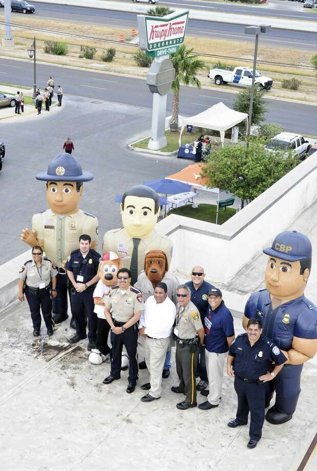 Law enforcement agencies pose for photos at the Krispie Kreme Doughnuts' rooftop during the Cops on Tops fundraiser for the Special Olympics of Texas in April 2013. (Staff file photo)