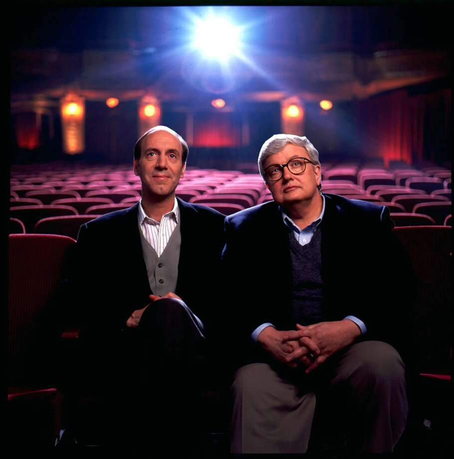 "This undated file photo originally released by Disney-ABC Domestic Television, shows movie critics Roger Ebert, right, and Gene Siskel. The Chicago Sun-Times is reporting that its film critic Roger Ebert died on Thursday, April 4, 2013. He was 70. Ebert and Siskel, who died in 1999, trademarked the ""two thumbs up"" phrase. (AP Photo/Disney-ABC Domestic Television)"