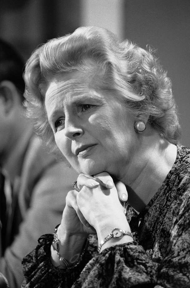 "In this Sept. 14, 1977 file photo, British Conservative Party Leader Margaret Thatcher listens to a reporters question during a press conference at the British Embassy in Washington. Ex-spokesman Tim Bell says that Thatcher has died. She was 87. Bell said the woman known to friends and foes as ""the Iron Lady"" passed away Monday morning, April 8, 2013. (AP Photo/File)"