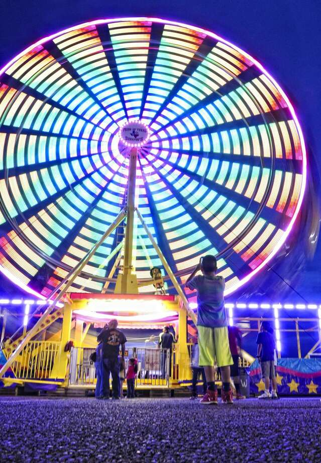 A boy takes photos of the Ferris wheel at the Pride of Texas Show on Friday evening at the Gateway Center parking lot. The carnival will be in Laredo until Sunday. (Photo by Ulysses S. Romero/Laredo Morning Times)