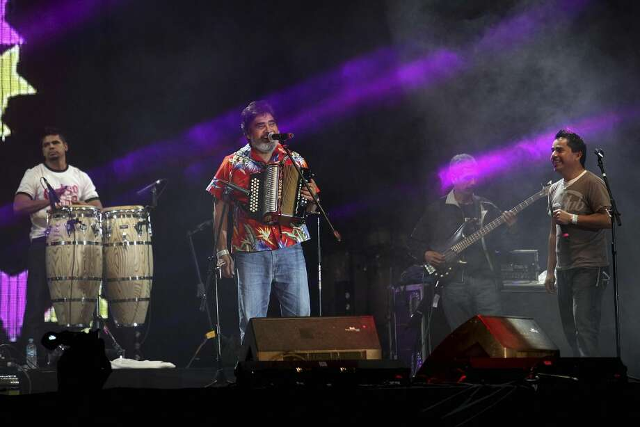 Mexican singer and accordionist Celso Pina performs with his band on the last night of the Cumbre Tajin 2013 music festival in Papantla, Mexico, Monday, March 25, 2013. (AP Photo/Felix Marquez)