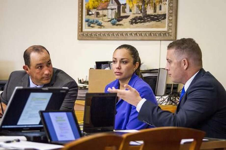 Former Albuquerque police officers Keith Sandy, left, and Dominique Perez, right, sit with Monnica Garcia part of legal defense for Sandy, during opening statements in their murder trial in Bernalillo County Court court Monday, Sept.19, 2016 in Albuquerque, NM. Perez and Sandy,are charged with the 2014 fatal shooting of James Boyd. (AP Photo/Juan Labreche) (AP Photo/Juan Labreche, Pool)