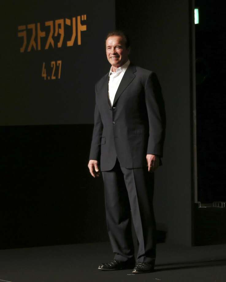 "Actor Arnold Schwarzenegger poses for photographers during a press conference to promote his latest film ""The Last Stand"" in Tokyo, Thursday, Feb. 21, 2013. (AP Photo/Koji Sasahara)"