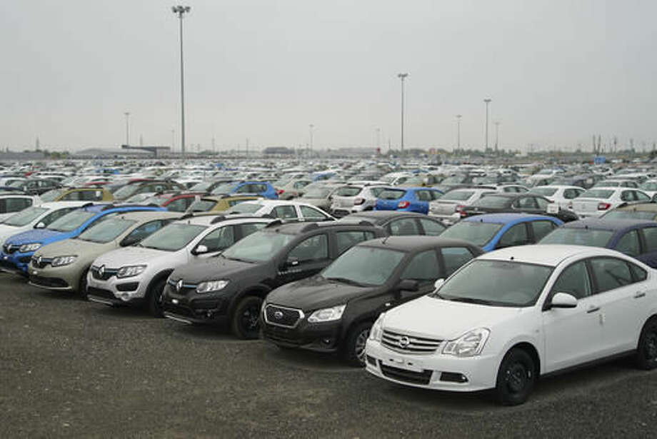 In this photo taken on Thursday, Sept. 1, 2016, hundreds of unsold cars are parked at a car producing factory parking lot in Togliatti, Russia. The Russian city of 700,000 was long a stronghold of solid industrial jobs centered on producing the unfashionable but reliable Lada compact automobiles. But Russia's economic upheavals have adversely affected the city.( AP Photo/Mstyslav Chernov)
