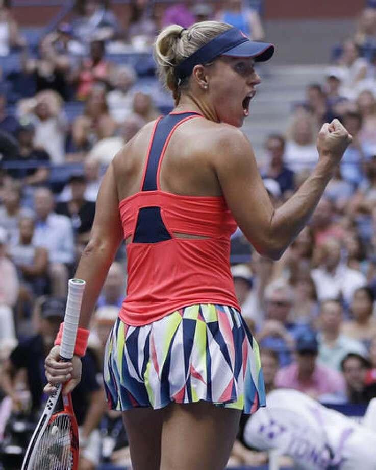 Angelique Kerber, of Germany, reacts after winning the first set against Karolina Pliskova, of the Czech Republic, during the women's singles final of the U.S. Open tennis tournament, Saturday, Sept. 10, 2016, in New York. (AP Photo/Julio Cortez)