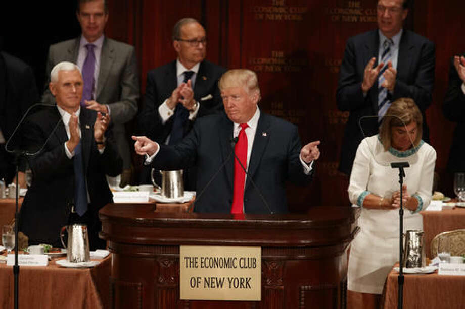 Republican presidential candidate Donald Trump speaks to the Economic Club of New York, Thursday, Sept. 15, 2016, in New York. Republican vice presidential candidate, Indiana Gov. Mike Pence applauds at left. (AP Photo/ Evan Vucci)