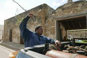 Jose Orlando Villarreal, whose family has lived for seven generations in San Ygnacio, Texas, works on the Treviño-Uribe Ranch, whose first structure was built in 1830. It is now being restored by local artisans. Wednesday, Sept. 15, 2016. (Billy Calzada/San Antonio Express-News via AP)