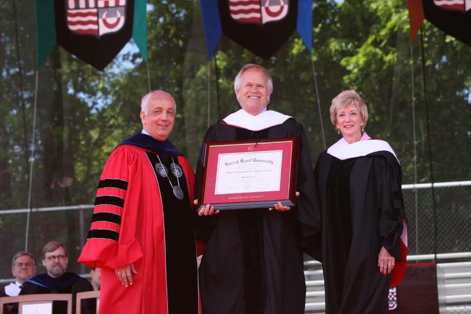 Dick Ebersol, center,  stands with SHU President Anthony Cernera, left, and Linda McMahon after receiving an honorary degree  at Sacred Heart University's Commencement ceremony on Sunday. Photo: B.K. Angeletti / Connecticut Post