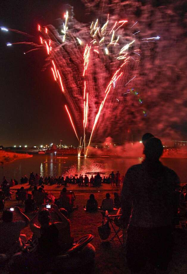 Hundreds of people enjoy the 4th of July fireworks display in this file photo.