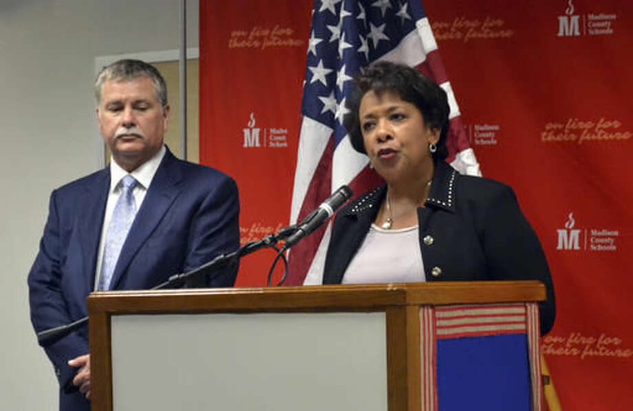 U.S. Attorney General Loretta Lynch, right, speaks at Madison Central High School in Richmond, Ky., Tuesday, Sept. 20, 2016. Listening at left is Kerry Harvey, a U.S. Attorney in Kentucky. Lynch was in Kentucky to raise awareness of prescription drug and heroin abuse as part of an Obama administration effort. (AP Photo/Dylan Lovan)