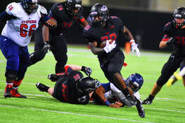 Langham Creek senior rusher Toneil Carter carries the ball against Cy Springs Friday night at Cy-Fair FCU Stadium. Carter posted another terrific game for the Lobos, carrying the ball 32 times for 283 yards and five touchdowns.