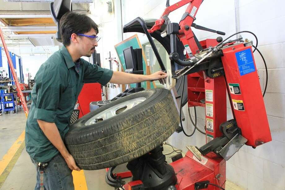 Laredo Community College transportation technology student Oscar Ortiz utilizes the Hunter Tire Mounting Machine, a recent addition to the college's automotive technology program, donated by Toyota of Laredo. The training tool will benefit LCC automotive technology students, as they experience hands-on learning and gain real-world training to what is similarly found within the automotive industry.