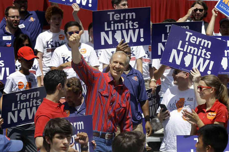 "In this Aug. 17, 2016 photo, Illinois Gov. Bruce Rauner participates in a Republican rally during Governors Day at the Illinois State Fair in Springfield, Ill. With the help of Rauner's deep pockets, Republicans are spending record amounts to compete in Illinois' legislative races this fall, trying to whittle away at the Democratic super majorities that stand in the way of the former venture capitalist's plan to ""turn around"" the state and solve its momentous budget problems. (AP Photo/Seth Perlman)"