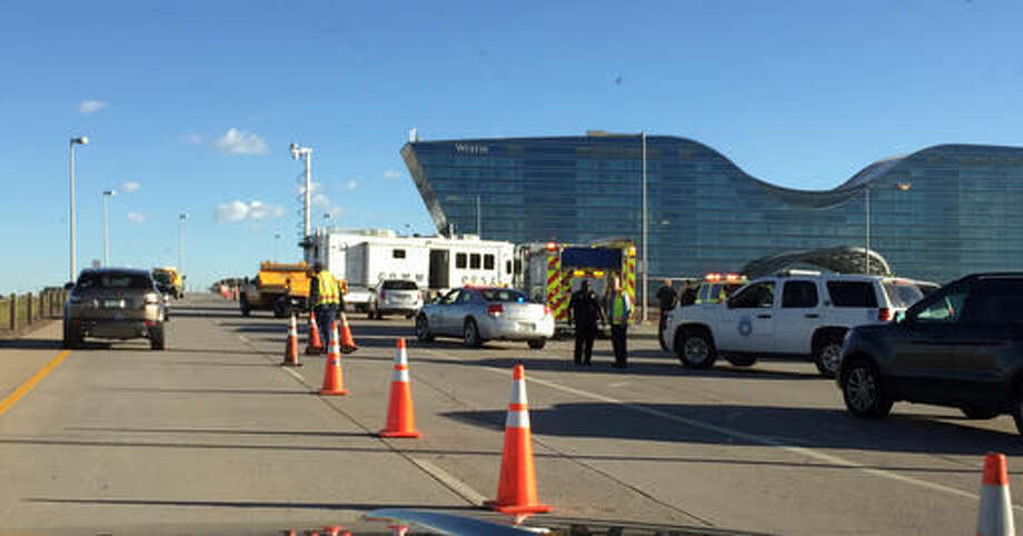 In this photo provided by Jennifer Ward, Traffic is diverted at Denver International Airport after a suspicious item was found Thursday, Sept. 15, 2016, in Denver, Colo. Access to the airport has been reopened after a police bomb squad checked and cleared a suspicious package. (Jennifer Ward via AP)