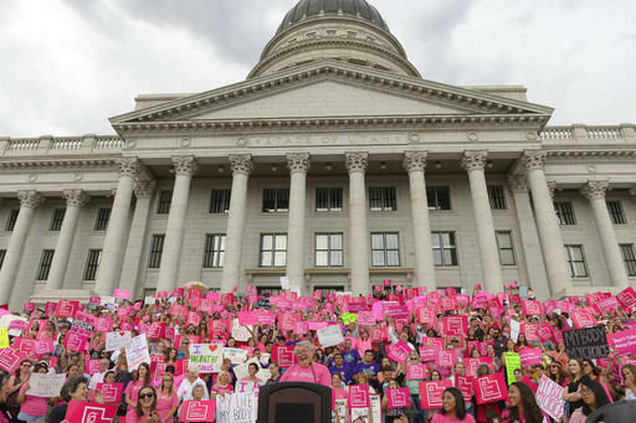 FILE - This Aug. 25, 2015, file photo, Karrie Galloway, CEO of Planned Parenthood Action Council, laughs as the roar of the crowd drowns out her speech at the state Capitol, in Salt Lake City. A judge is ordering the state of Utah not to stop funding its Planned Parenthood branch over advocacy for legal abortion or unproven allegations against the national organization. (Leah Hogsten/The Salt Lake Tribune via AP, File)