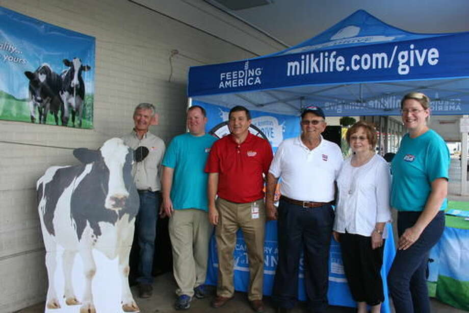 In this Sept. 13, 2016 photo, from left, John Mitchell with Prairie Farms, Mark Farmer with with the Southeast United Dairy Industry Association, Peanut Wright from Prairie Farms, David and Margaret Saylor from Sayland Dairy in Sulphur Springs, and Denise Jones with the American Dairy Association of Tennessee in Johnson City, Tenn. ( Guinn Legg/The Johnson City Press via AP)