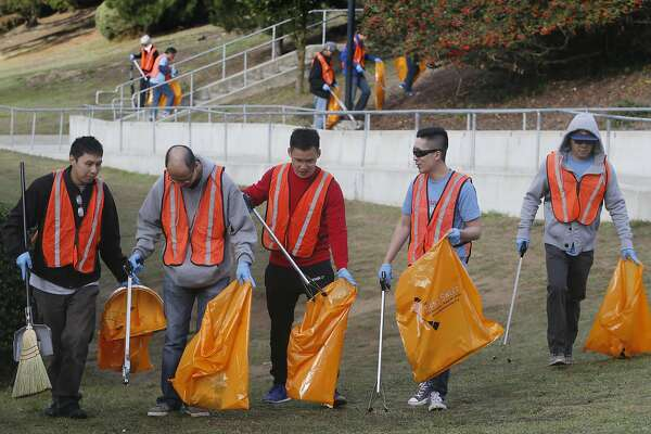 Volunteers spread out across the Lowell High School campus to pick up trash for the DPW's Community Clean Team program in San Francisco, Calif. on Saturday, Oct. 22, 2016.