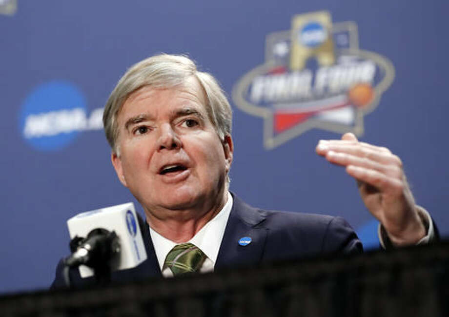 FILE - In this March 31, 2016, file photo, NCAA President Mark Emmert answers questions during a news conference at the men's NCAA Final Four of the NCAA college basketball tournament in Houston. Basketball-crazed North Carolina has lost its next chance to host NCAA men's basketball tournament games along with several other championship events due to a state law that some say can lead to discrimination against LGBT people. Emmert said in statement Monday, Sept. 12 night that the governing body will delay announcements on future championship sites until early next year. (AP Photo/David J. Phillip, File)