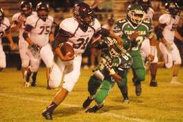 Abernathy running back Mark Pando, 31, runs past Floydada's Gerry Reyes, 84, and gains yardage in a football game at Floydada Friday night. Pando rushed for 205 yards as the Antelopes stayed unbeaten in District 2-2A with a 41-18 victory.
