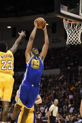 Golden State Warriors forward Kevon Looney (5) dunks during an NBA preseason basketball game against the Los Angeles Lakers Wednesday, Oct. 19, 2016, in San Diego. (AP Photo/Denis Poroy)