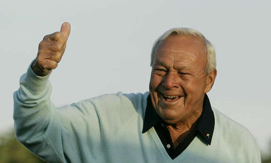 """File- This April 5, 2007, file photo shows former Masters champion Arnold Palmer acknowledging the crowd after hitting the ceremonial first tee shot prior to the first round of the 2007 Masters golf tournament at the Augusta National Golf Club in Augusta, Ga. Palmer, who made golf popular for the masses with his hard-charging style, incomparable charisma and a personal touch that made him known throughout the golf world as """"The King,"""" died Sunday, Sept. 25, 2016, in Pittsburgh. He was 87. (AP Photo/David J. Phillip, File)"""