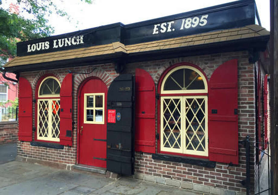 This Sept. 9, 2016 photo shows the exterior of Louis Lunch, a longtime eatery in New Haven, Conn. Louis was recognized by the Library of Congress as the U.S. birthplace of the hamburger. Burgers are made on a small gas grill and the restaurant does not serve ketchup. (AP Photo/Beth J. Harpaz)