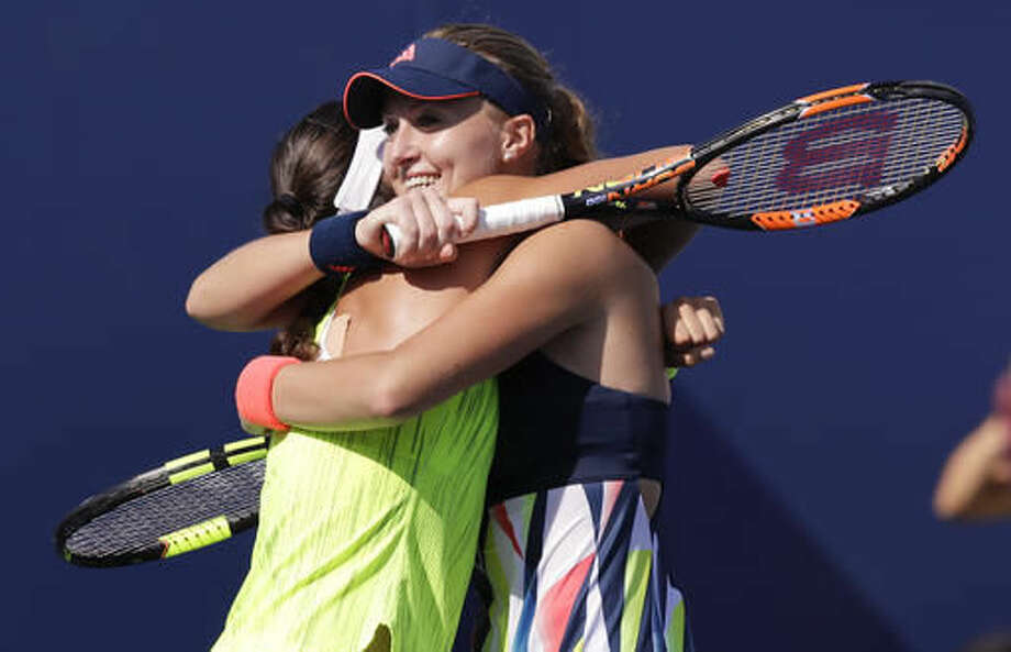Kristina Mladenovic, of France, right, hugs doubles partner Caroline Garcia, of France, after winning their semifinal match against Martina Hingis, of Switzerland, and Coco Vandeweghe, of the United States, at the U.S. Open tennis tournament, Thursday, Sept. 8, 2016, in New York. (AP Photo/Charles Krupa)