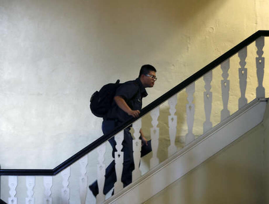 In this Thursday, Sept. 8, 2016 photo, cadet Charlie Dong, of Shanghai, walks up a staircase at the New York Military Academy in Cornwall-on-Hudson, N.Y. While Republican presidential nominee, Donald Trump, talks tough about dealing with China, his old military prep school is building bridges to that country. The New York Military Academy began classes this fall with new Chinese backing and a former New York City high school principal originally from China in charge. (AP Photo/Mike Groll)