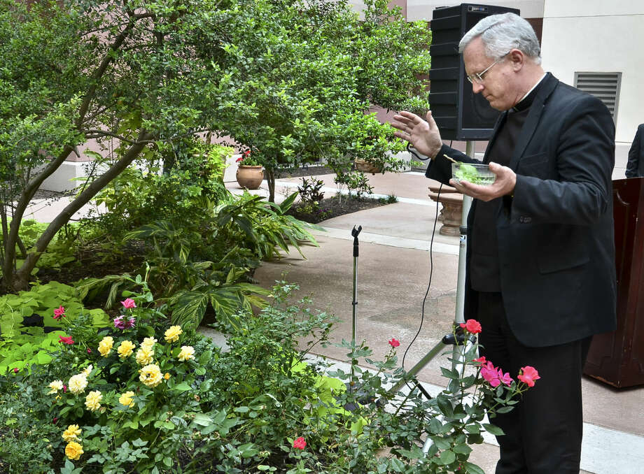 In this April 2012 file photo, Father James Harris blesses the rose garden at Laredo Medical Center during the annual Rose Garden Ceremony held in observance of National Donate Life Month.
