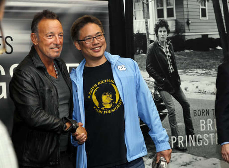 "Bruce Springsteen, left, greets a fan at the launch of his autobiography ""Born to Run"" at the Barnes & Noble in the New Jersey town where he grew up Tuesday, Sept. 27, 2016, in Freehold, N.J. (AP Photo/Mel Evans)"