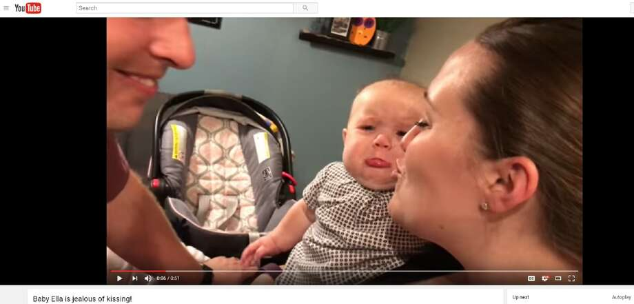 A video of a baby crying every time her parents kiss has gone viral on Facebook. Photo: YouTube Screen Grab