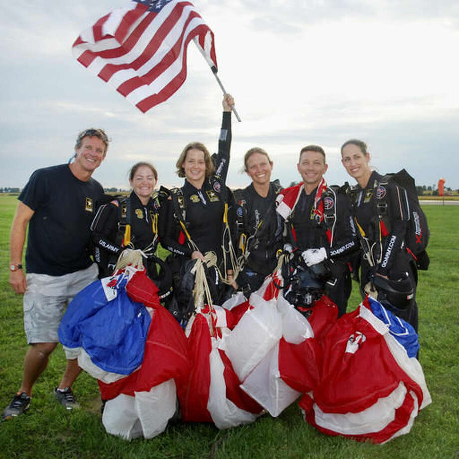 In this photo provided by Sherri Jo Gallagher, the U.S. Army's Golden Knights' women's 4-way team pose with their coach and camera flyer for a photo after taking gold at the World Parachuting Championships at Skydive Chicago near Ottawa, Ill., Thursday, Sept. 15, 2016. From left are coach Solly Williams, Jen Davidson, Laura Davis, JaNette Lefkowitz, camera flyer Scott Janise, and Dannielle Woosley. (Sherri Jo Gallagher via AP)