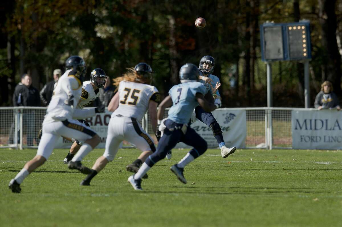 Northwood University's quarterback Joe Garbarino throws to teammate Andre Carter in the first half of Northwood's home game against Michigan Tech Saturday afternoon.