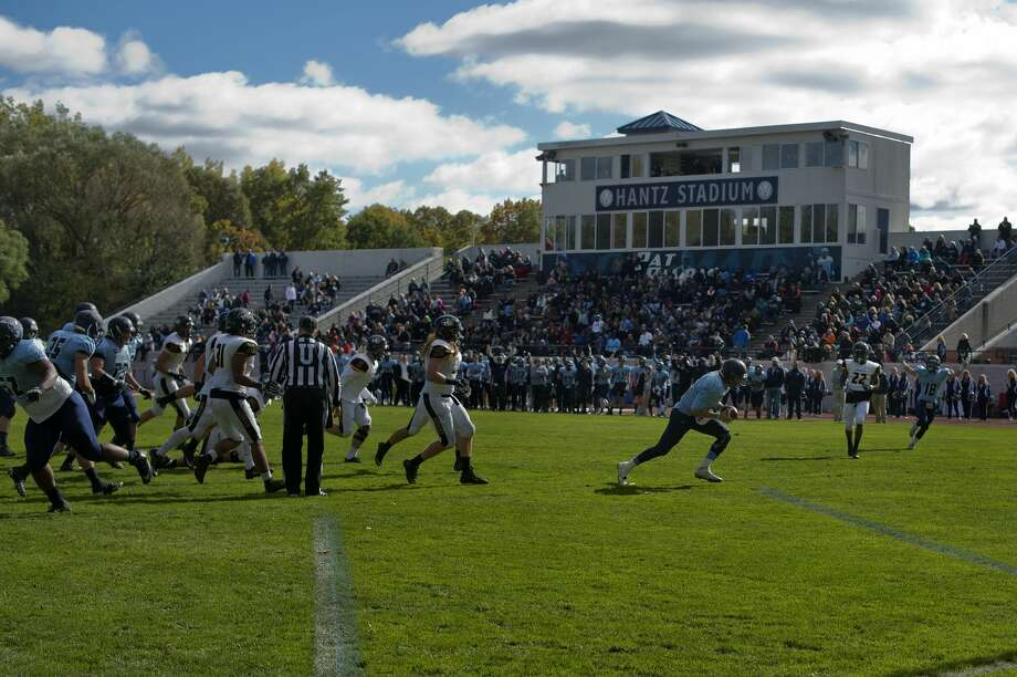 Northwood University's quarterback Joe Garbarino runs the ball into the end zone scoring a touchdown in the first half of Northwood's home game against Michigan Tech Saturday afternoon. Photo: Brittney Lohmiller/Midland Daily News/Brittney Lohmiller