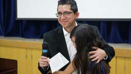 Ivan Cantu gets a hug from his daughter Annalyssa, 10, after speaking at the Department of Human Services' first-ever Transition Out of Poverty celebration in San Antonio, Texas on October 22, 2016. Cantu completed San Antonio's Training for Job Success program this year. Ray Whitehouse / for the San Antonio Express-News