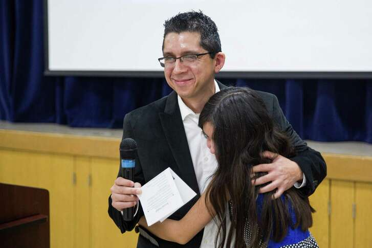 Ivan Cantu gets a hug from his daughter Annalyssa, 10, after speaking at the Department of Human Services first-ever Transition Out of Poverty celebration in San Antonio, Texas on October 22, 2016. Cantu completed San Antonio's Training for Job Success program this year. Ray Whitehouse / for the San Antonio Express-News