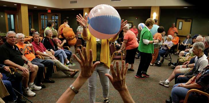 Beach balls being bounce around at the Interfaith Care Partners outreach session for Alzheimer's and other disabled people during an entertaining day of arts/crafts activities at Lakewood United Methodist Church Oct. 10, 2016, in Spring. ( James Nielsen / Houston Chronicle )